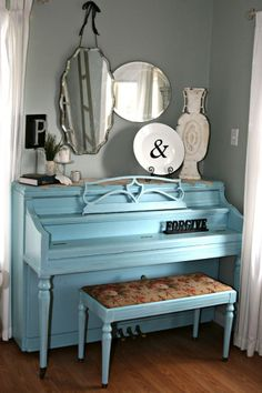 painted piano: What a great idea to pick up a tired old finish and make a new masterpiece!  Love it!  Need to get a pro spray gun for this one Amy!