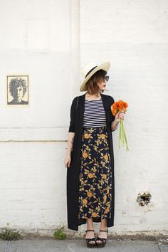 striped top, patterned skirt, black wedges, black long duster sweater, hat