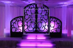 Simplistic elegance, paired with the right uplighting can create not only a scenic stage, but a place for your guests to take photos. #Event #decor #party #lights #love #style #chic #modern #purple  #ThemedParty #ThemeParty #ThemeStage #Event #decor www.SensationalExperiences.com