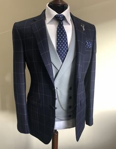 Wedding Suits Raise your sartorial game with this navy, window-pane check suit jacket from our bespoke collection. Style with a pale grey waistcoat and matching trousers for the perfect city chic wedding look! Wedding Suit Hire, Best Wedding Suits, Chic Wedding, Grey Wedding Suits For Men, Men's Wedding Wear, Wedding Makeup, Wedding Favors, Wedding Ceremony, Wedding Invitations