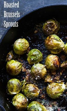 Brussels sprouts, oven-roasted with garlic, olive oil, lemon juice, salt, pepper, and Parmesan cheese. Perfect for Thanksgiving! On SimplyRecipes.com