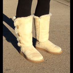 💋HP 9-20-16💋UGGS Sand Colored Bailey Button Tall Excellent condition, worn 2-3 times. Leather outer, sheepskin lining. No stains. Buttons are perfect. These are not mine so no offers please. Ugg Shoes Winter & Rain Boots