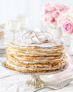More than two dozen paper-thin French pancakes form the towering Crêpe Cake with Coconut Filling that graces our January/February cover. This showstopping dessert is one you won't be able to resist. Visit victoriamag.com for the recipe!