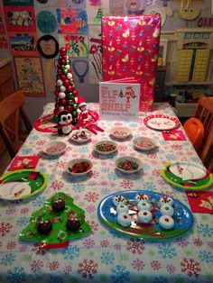 Day 1, 2014 - Our Elf on the Shelf Arrival Breakfast - Sprinkle served reindeer donuts, snowman donuts, and North Pole pancakes with whipped cream and red/green candy (gummy bears, m&ms, sour patch kids, chocolate chips, tootsie rolls and sprinkles), she also brought a new penguin friend and a present with two elf on the shelf nightgowns - Elf on the Shelf