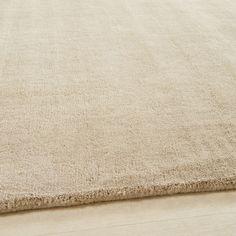 Tapis à poils courts en laine beige 140 x 200 cm | Maisons du Monde