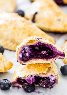 12 Sweet And Savory Empanada Recipes Blueberry Goat Cheese Empanadas - not your everyday run of the mill empanadas. These empanadas are stuffed with creamy goat cheese and fresh blueberries. Just Desserts, Delicious Desserts, Yummy Food, Blueberry Goat Cheese, Mexican Food Recipes, Dessert Recipes, Brunch Recipes, Blueberry Recipes, Le Diner