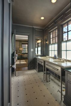 masculine, modern bath. charcoal + stainless steel + mood lighting + vanities against the window + floor tile