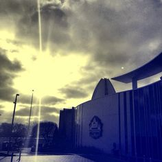 Early morning image of the sun coming through the clouds above the Pro Football Hall of Fame in Canton, Ohio.