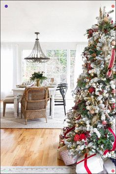 Home For Christmas Tips For Seasonal Decorating Zevy Joy Red And White Styled Flocked Christmas Tree With Hints Of Plaid And Velvet Ribbon And Accessories Throughout The Living Room. Flocked Christmas Trees, Cozy Christmas, Christmas Decorations, Christmas Trimmings, Christmas Wishes, Farmhouse Lighting, Farmhouse Decor, Vintage Farmhouse, Farmhouse Ideas