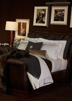 Penthouse Suite bedding mixes menswear inspired sheeting with rich cashmere throws and gilded pillows