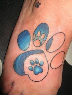 Heart, paw print tattoo
