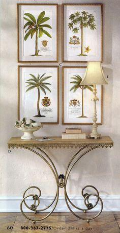 set of 4 Ehret Palm Tree Prints hanging over a console table. All from the Ballard Designs catalog (in the past.)