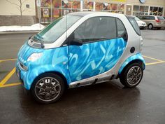 """This Smart fortwo coupe kind of looked like it was sporting a faux tie-dye design in various shades of blue from a distance, but, upon closer inspection, this """"skin"""" is actually composed of distorted number both in numeral form and spelled out as """"two"""". New Smart Car, Smart Car Body Kits, Smart Auto, My Dream Car, Dream Cars, Car Camper, Campers, Smart Fortwo, Pedal Cars"""