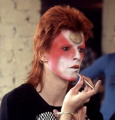 Credit: Roger Bamber/Rex Features David Bowie, putting the finishing touches to his makeup in 1973.