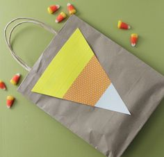 Decorate trick-or-treat bags with washi tape candy corn art!