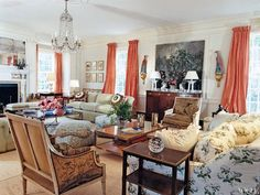 Tory Burch's living room in her Southhampton estate. Very pretty, traditional... I spy an old Colefax and Fowler cabbage rose chintz!