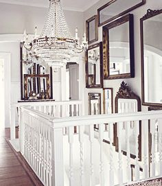 This home, built in 1868 in Jacksonville, Illinois has a mostly neutral palette. The owner has added lots of gilt mirrors along withsparkling chandeliers in every room & ornate furniture. It is certainly glamorous, but it has a very lived in, comfortable feel to it as well.photos by bjorn…