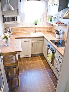 Tiny Kitchen Renovation with Faux Painted Brick Backsplash tiny kitchen makeover with painted backsplash and wood tile floors - Pudel-design featured on New Kitchen, Kitchen Decor, Kitchen Small, Kitchen Interior, Kitchen Storage, Kitchen Wood, Kitchen Seating, Kitchen Paint, Narrow Kitchen
