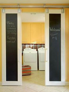 Barn doors cover a laundry room - love the chalk board, only two small door that index like vertical blinds - takes up less space when open