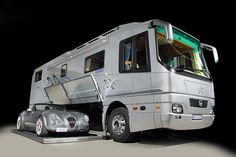 Performance Compact. This tall and luxury Rv has enough room on its bottom compartment to hold a small car (Mercedes shown in picture), made by Volkner mobile. Since Volkner builds their Rv's from the ground up, there is no price point however, considering the luxury it would be fair to guess to be over the $100,000 dollar mark. They do rent trailers.
