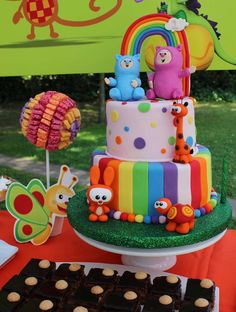 Rainbow cake at a Baby TV birthday party! See more party planning ideas at CatchMyParty.com!