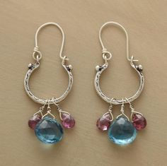 "EBBTIDE EARRINGS -- Suggested by oceanside walks at sunset, Jes MaHarry's sterling silver hoops swing with glimmering drops of London blue topaz and garnets. Handmade sterling silver earwires. Made in USA. Exclusive. 1-5/8""L."