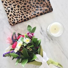 @stylemba makes our flowers look so good! Love this shot (and the leopard clutch). #sendhappy
