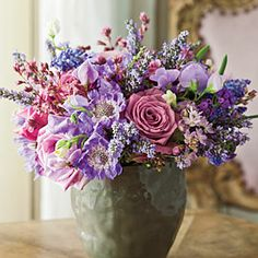 Arrange a Lush Centerpiece    Use a mix of French lavender, chive blossoms, anemones, grape hyacinths, roses, and rex begonia leaves to create a bouquet in varying shades of purple and pink. If you're nervous about arranging an elaborate bouquet, Todd suggests finding an assortment of vessels that look good holding one flower each and then clustering them together.