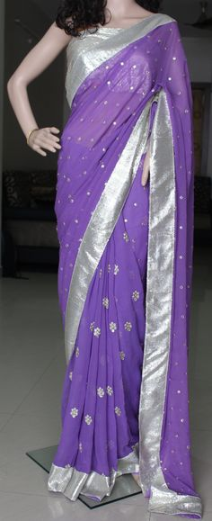 Pure georgette half and half saree in pleasant lavender colour with all over goldish silver butis. whole saree is edged with sequin border  Blouse: Sequin fabric same as border  Contact us at askbhama@gmail.com or whatsapp 9010396655 for bookings and details
