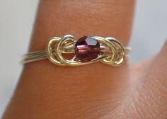 Dark Amethyst love knot ring sterling silver wire by MandaWolf