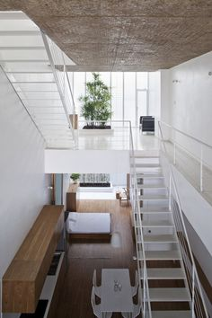Vietnamese architects Sanuki + Nishizawa adapted the prototypical Vietnamese tube house to create a tall, narrow residence that lets daylight penetrate its walls and floors.