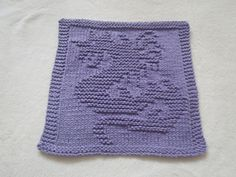 """This dishcloth used 46 grams to complete and its finished measurements are 10 x 9 3/4"""" ."""