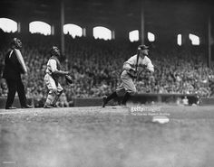 Catcher Buck Crouse of the Chicago White Sox and umpire Bill Guthrie watch as Lou Gehrig of the New York Yankees completes his swing for his third home run, following Babe Ruth's in the seventh inning on May 4, 1929 at Comiskey Park in Chicago, Illinois.