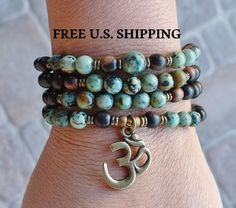 108 Mala, African Turquoise, Om Mala,  wrap Bracelet or Necklace, Buddhist Rosary, Om Yoga, Yoga wrap,  prayer beads, Reiki Charged by LifeForceEnergy on Etsy https://www.etsy.com/listing/176332123/108-mala-african-turquoise-om-mala-wrap
