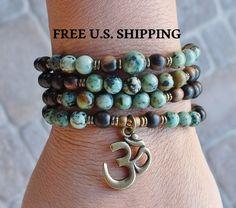 108 Mala, African Turquoise, Om Mala,  wrap Bracelet or Necklace, Buddhist Rosary, Om Yoga, Yoga wrap,  prayer beads, Reiki Charged by LifeForceEnergy on Etsy https://www.etsy.com/listing/176332123/108-mala-african-turquoise-om-mala-wrap