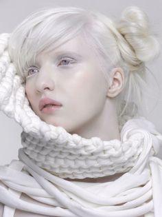 Nastya Zhidkova wearing a white scarf