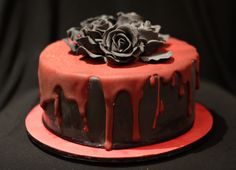 pretty cake black with black roses and red 'blood icing'. perfect for a gothic / dark / or vampire themed party.