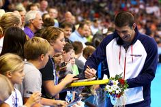 Michael Phelps signs autographs for fans during Day Seven of the 2012 U.S. Olympic Swimming Team Trials at CenturyLink Center on July 1, 2012 in Omaha, Nebraska.    Credit: Getty Images/Al Bello
