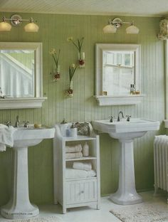 Cottage Style Bathroom: white pedestal sinks, green floor-to-ceiling beadboard walls and white beadboard ceiling.