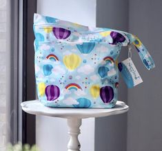 Up & Away - On-the-Go Wet/Dry Bag – Nuggles Designs Canada  Our On-the-Go Wet/Dry Bag is the PERFECT double compartment wetbag for daytime outings, daycare, swim/gym class. Just bring it all home and wash! Holds 6-8 cloth diapers and keeps wet and dry items separate.