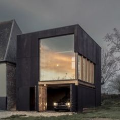 Blackened+timber+reading+room+extends++a+coastal+home+in+northern+France