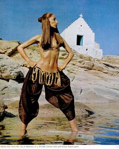 Maria rises from the sea at Mykonos in a $10,000 Zolotas belt and Kritsas harem pants. Life 1969
