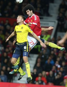 Marouane Fellaini of Manchester United in action with Ben Gibson of Middlesbrough during the Capital One Fourth Round match between Manchester United...