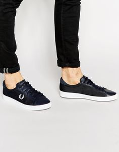 Trainers by Fred Perry Mesh upper Lace-up fastening Embroidered logo Chunky, flat sole Textured herringbone tread Treat with a leather protector 50% Real leather, 50% Textile Upper