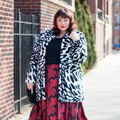 Fashion Trend: Pattern Mixing. Plus Size Blogger Amber from Style Plus Curves adds a black and white faux fur jacket over a red floral organza dress from Sydney's Closet.   Chicago, Chicago Blogger, plus size blogger, Style Plus Curves, Fashion Trend, Mixing Patterns, Mixing Prints, transitional fashion, Spring fashion, curvy girl fashion, formal dresses, plus size party dress