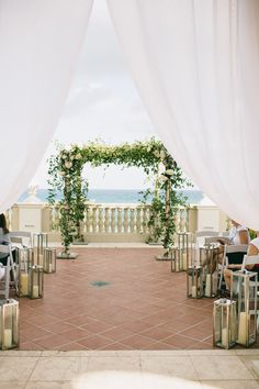 #lantern, #aisle-decor  Photography: Sarah Stephens Photography  Read More: http://www.stylemepretty.com/2014/05/20/bohemian-wedding-at-the-breakers/