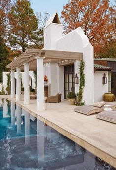Robbie's House:  The focus of the rear of the house, and the inspiration for its California look, is a 60-foot infinity pool and pavilion. Sunbathers and swi...