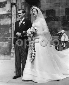 Topfoto - Preview 1119046 - Lady Rosemary Spencer Churchill, 23, youngest daughter of the Duke and Duchess of Marlborough, marries Mr Charles Robert Muir 28, at Christ Church Cathedral, Oxford. The reception was at Blenheim Palace and her HRH Princess Margaret was a guest. She is a friend of both the bride and groom. 26th June 1953