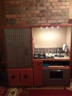 play kitchen from old entertainment center - this one is awesome .. someone pinned with no link or credit... I will try to find it!  who did this deserves credit!