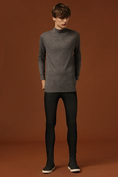 For a smart day look, wear a high neck jumper with black jeans and sports luxe style plimsolls. #newlook #menswear